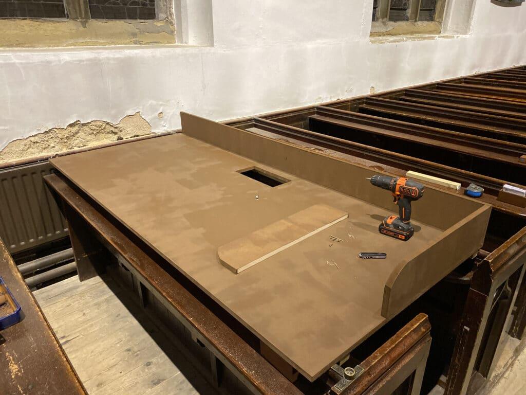 A partially assembled desk in-situ in its final location